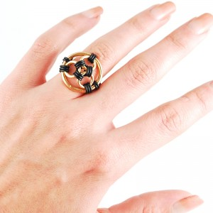 black rubber and gold color rubbermaille finger ring on hand