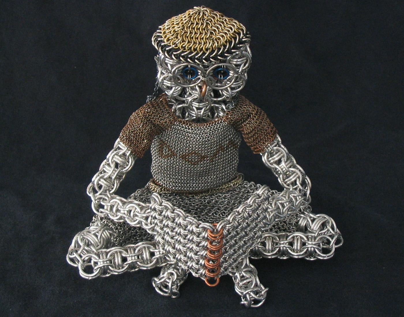 chainmaille sculpture man reading by Dave Austin