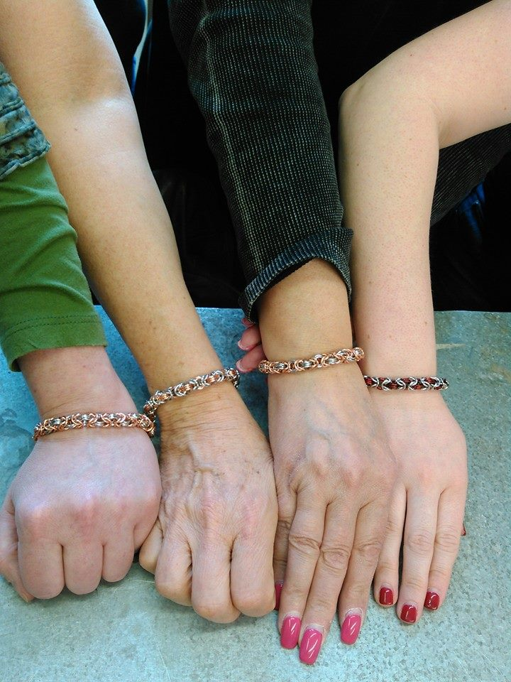 byzantine bracelet chainmaille on wrists from chainmaille class in Chicago