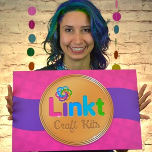 Rebeca Mojica holding Linkt Crafts Kit sign