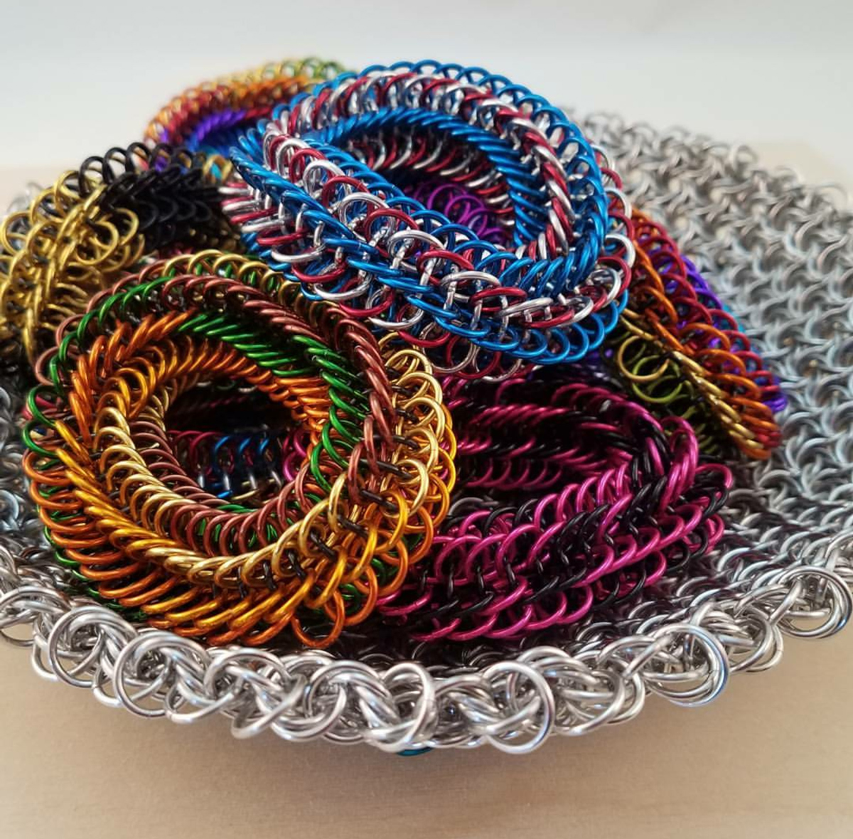 colorful Infinity Rose Fidget toy and bracelets in chainmaille moorish rose basket