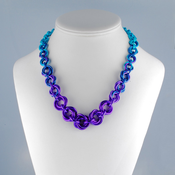 chainmail necklace in purple blue and turquoise on display form