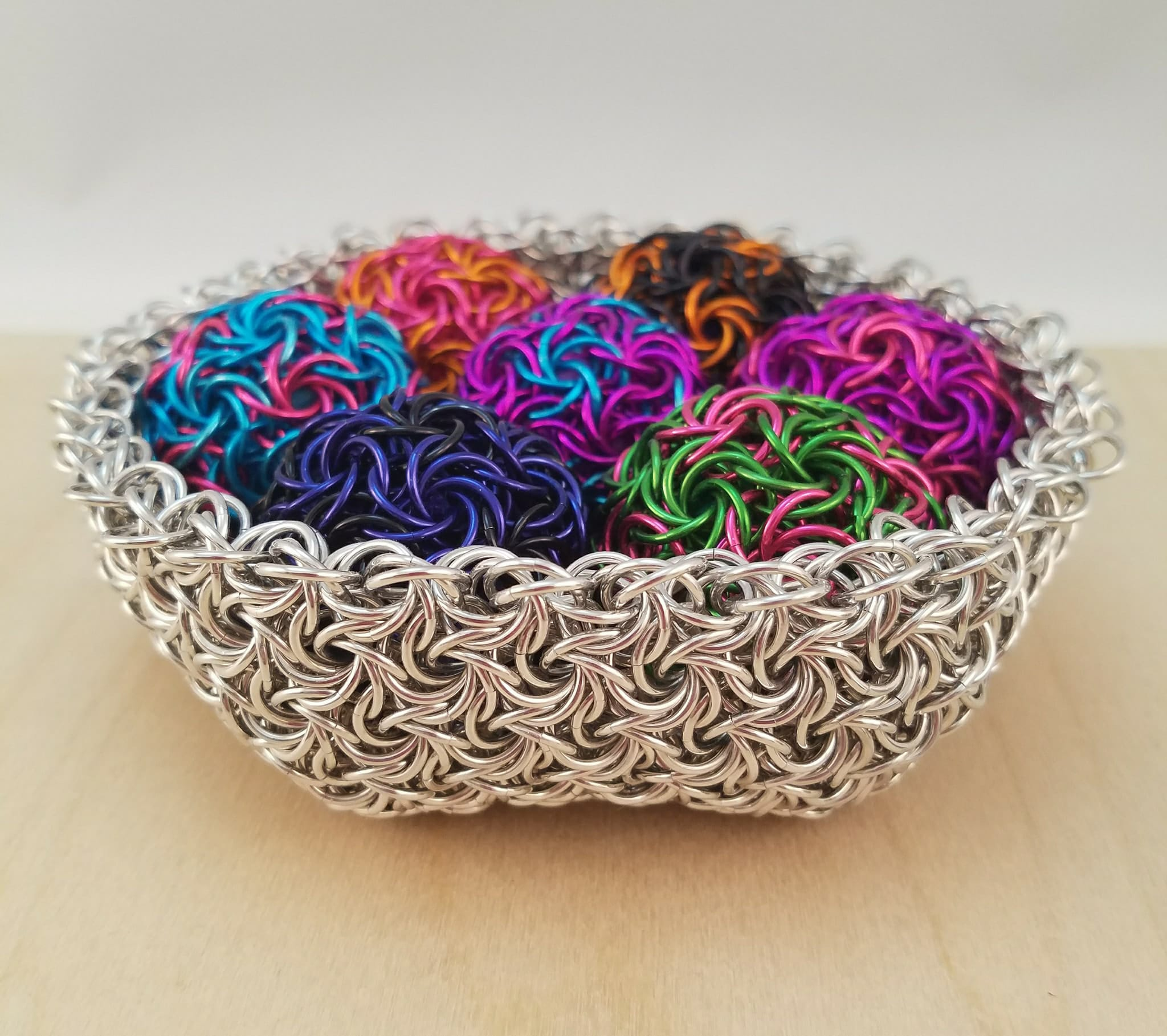 aluminum moorish rose basket with colorful moorish rose balls by lisa ellis