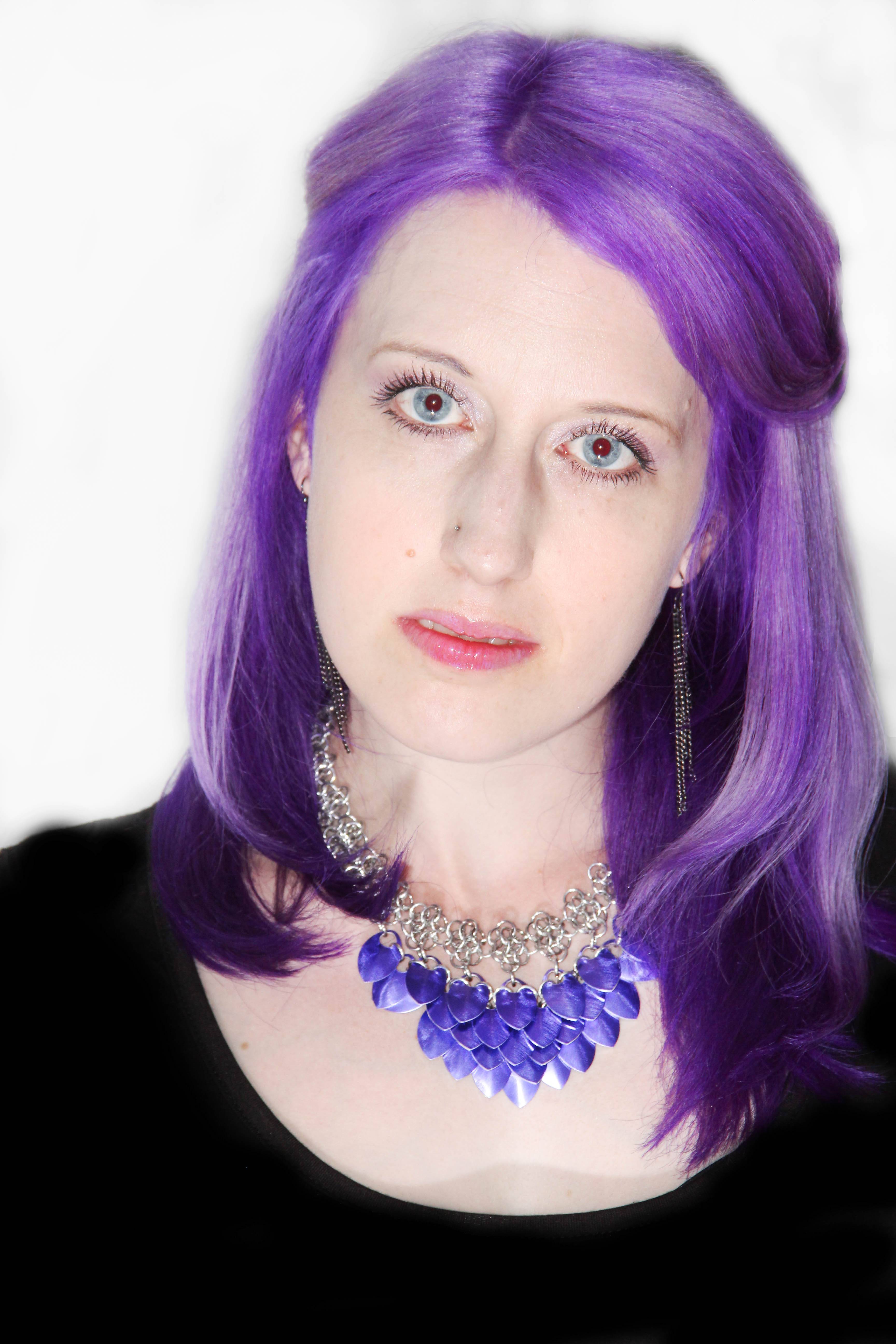 Woman with purple hair wearing purple and silver scalemaille necklace