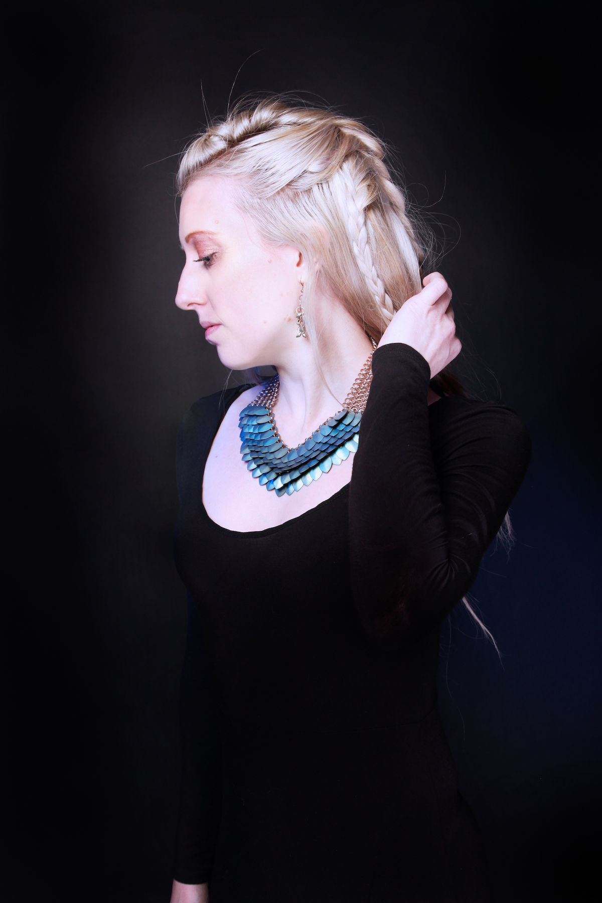 Scalemaille designer Sally of It Is Known wearing iridescent blue and green statement necklace