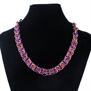wobble weave in copper and purple jump rings on black neck form