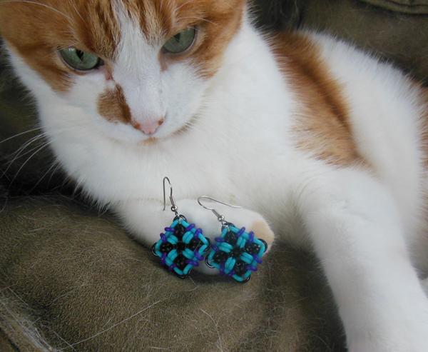 cat with biomechanical earrings