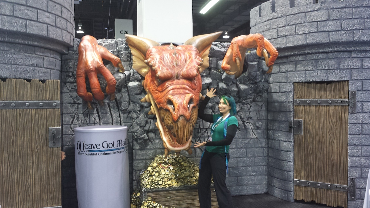 Weave Got Maille trade show booth dragon with Rebeca Mojica
