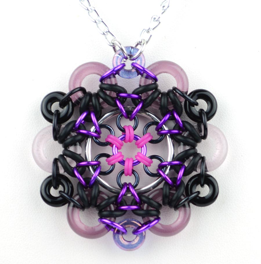 Space Oddity Pendant by Kat Wisniewski using glass rings and rubber rings