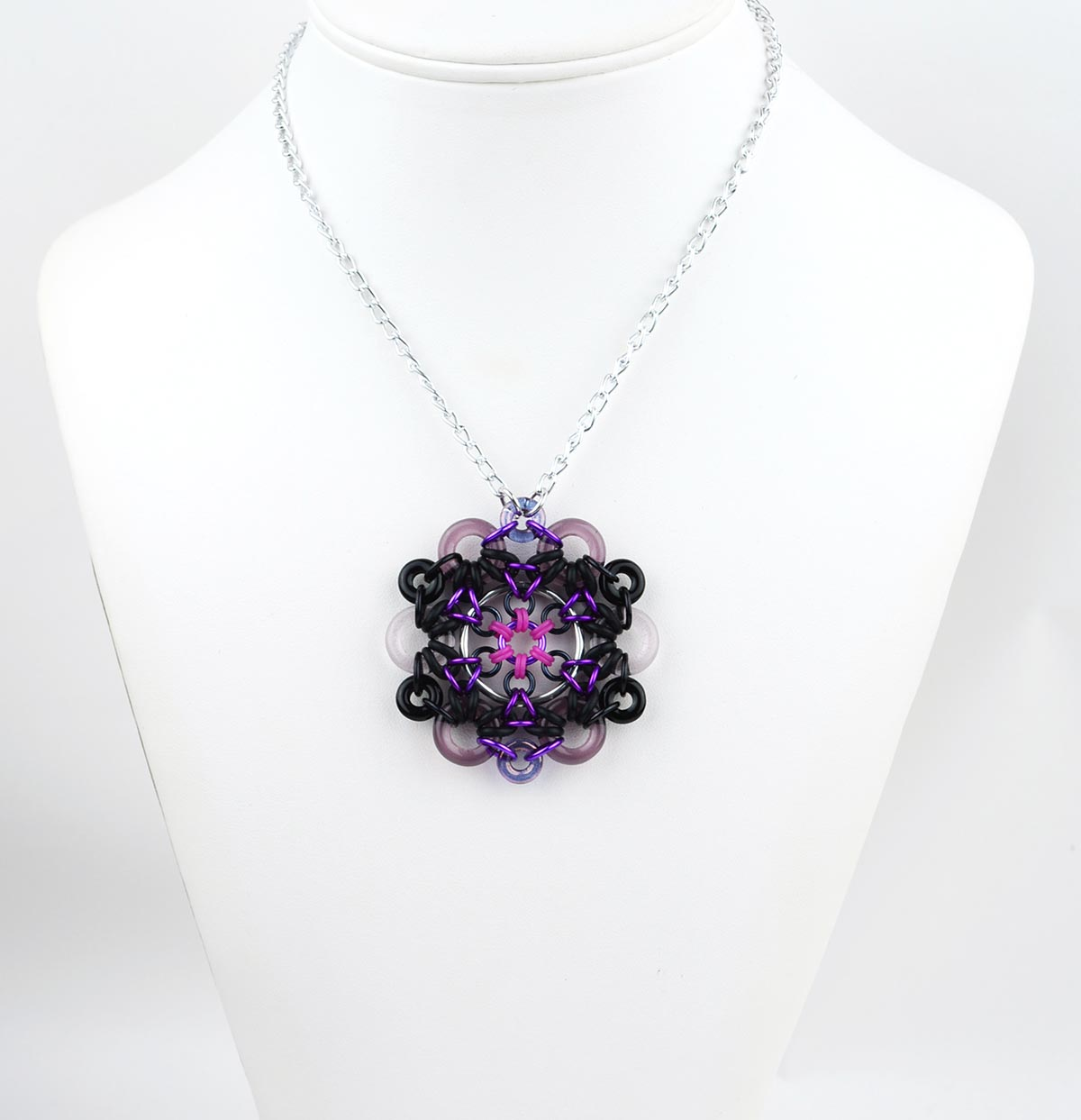 Space Oddity Rubbermaille Pendant in black purple and pink