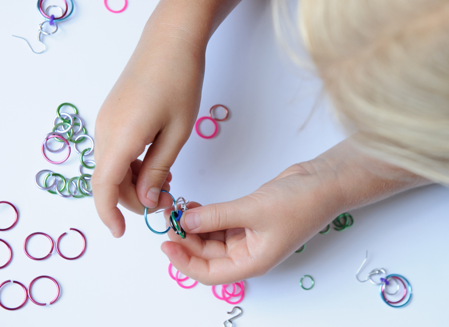 child's hands making chainmail linkt craft kits