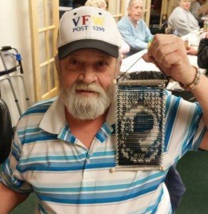 veteran holding POW MIA art made of chainmaille