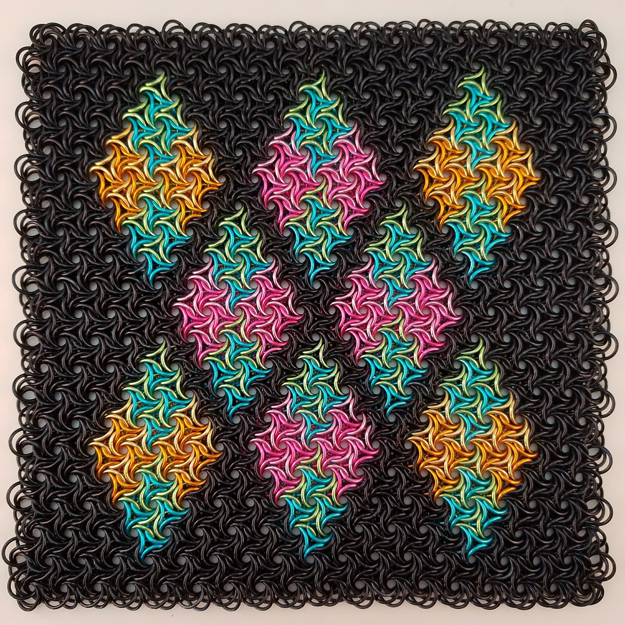 Black square of moorish rose with colorful diamond shaped inlay