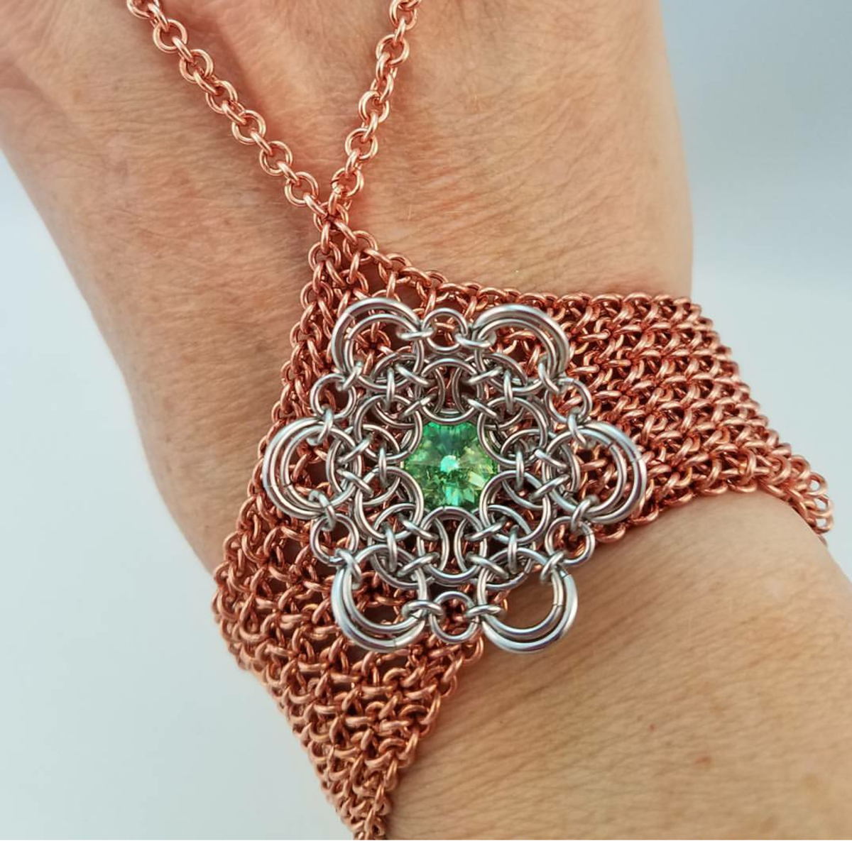 copper chainmaille handflower with aluminum and green stone decoration