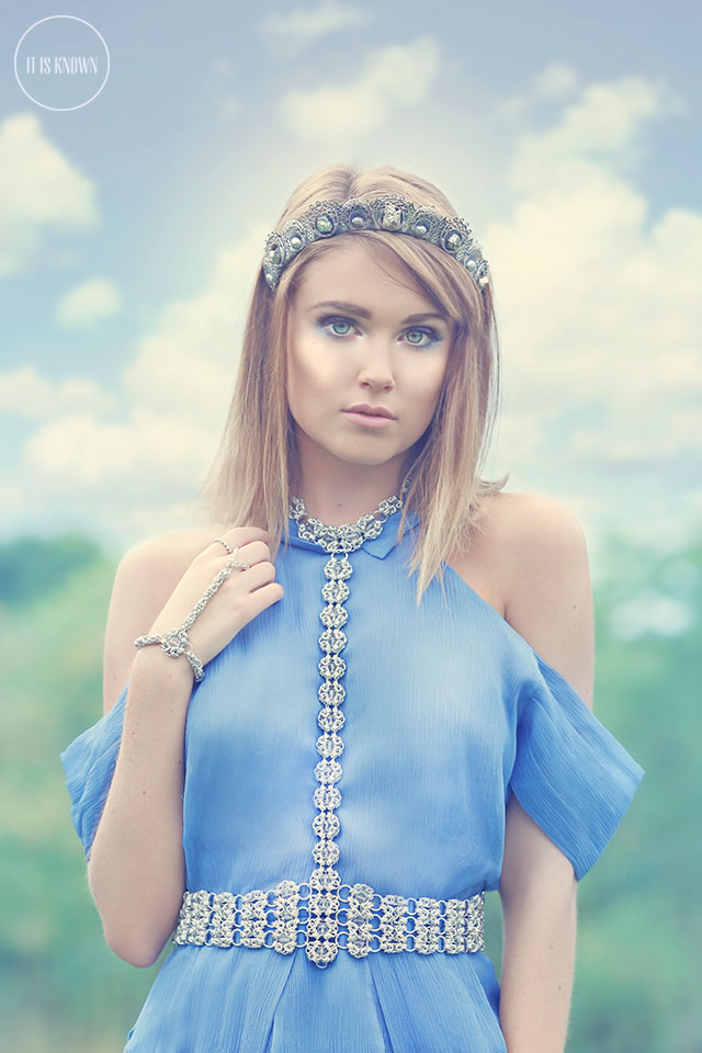 woman wearing cold shoulder blue dress with intricate chainmaille halter
