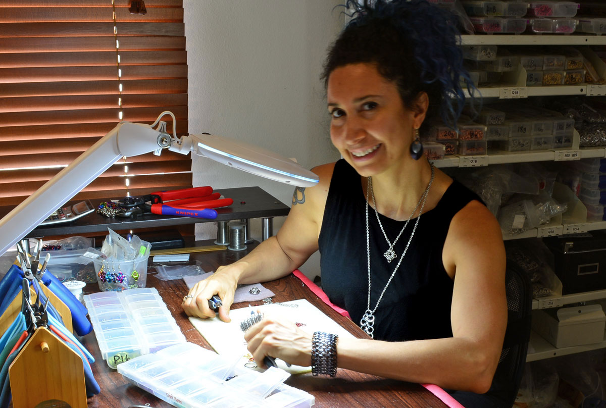 rebeca mojica smiling with her new brightech crafting lamp