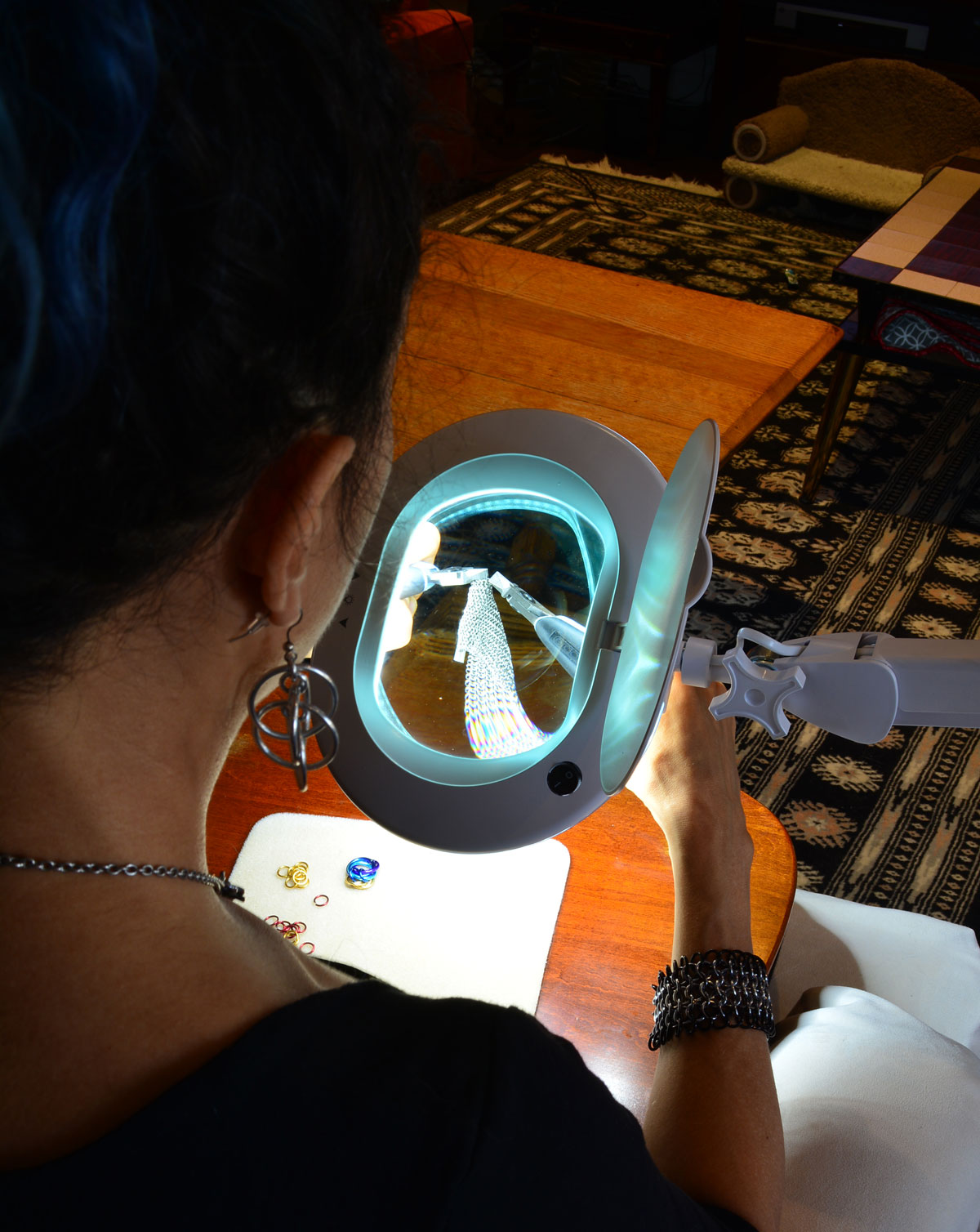 over the shoulder view of rebeca mojica making micromaille using brightech magnifier lamp