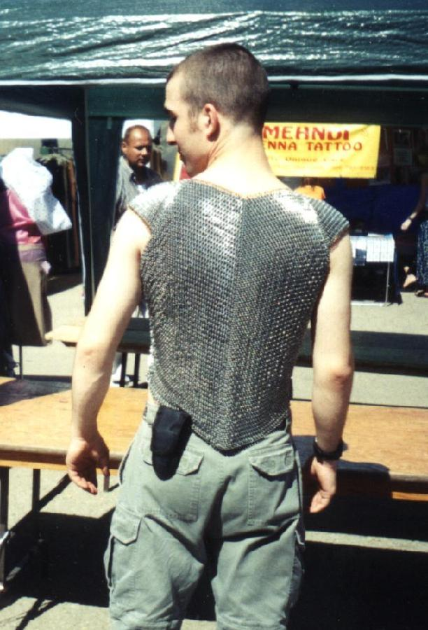 man wearing chainmaille vest in trinity weave