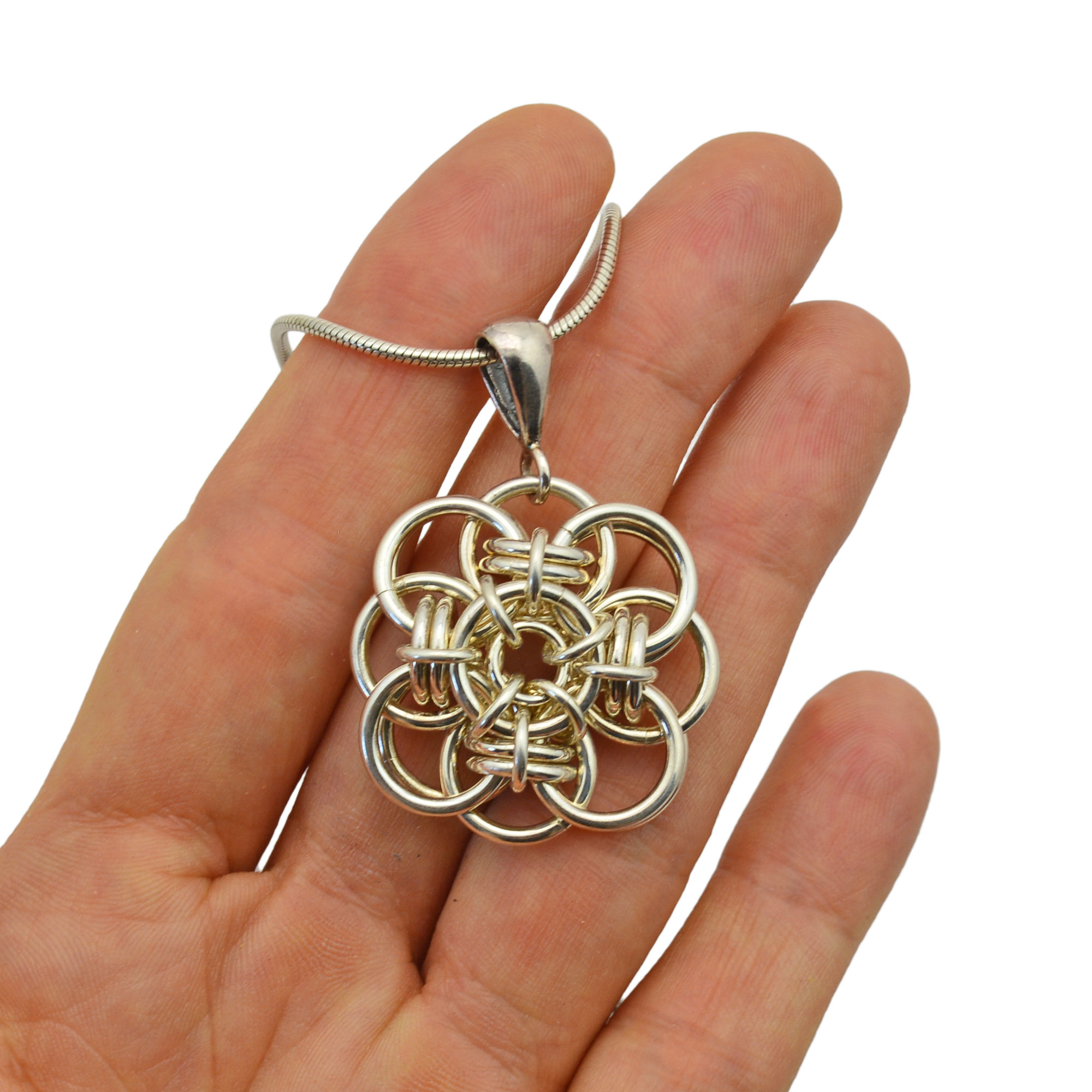quantum rose sterling silver pendant in palm